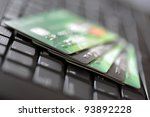 Credit cards on a laptop keyboard concept for e-commerce, consumerism or electronic banking - stock photo