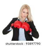 Beautiful businesswomen posing with boxing gloves. Isolated on white - stock photo