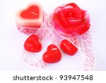 Heart and rose shape red candles  and ribbon on grey background. - stock photo