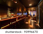 Stock photo bar counter with chairs in empty comfortable restaurant at night 93996670