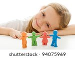 Happy little girl with her colorful clay people family - isolated - stock photo