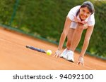 Competitive tennis player set to run at the clay court - stock photo