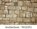 Granite stone blocks wall. - stock photo