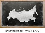 drawing of russia on chalkboard, drawn by chalk - stock photo
