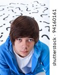 Teenager boy full of questions wondering - portrait - stock photo
