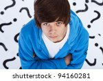 Quest of life - teenager boy wondering over question marks background - stock photo