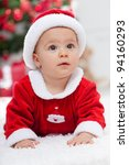 Christmas baby girl in front of the fir tree - closeup portrait - stock photo