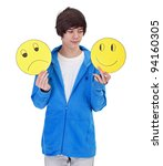 Choosing to be happy - teenager boy with cheerful and sad masks - stock photo