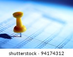 Yellow push pin in a date on calendar or planner - stock photo