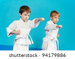 Two Boys Training Karate Kata...