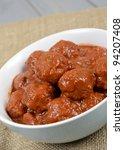 Xiu Mai - Vietnamese spicy pork meatballs in fragrant tomato sauce. - stock photo