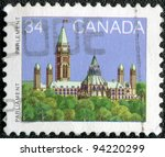 CANADA - CIRCA 1985: A stamp printed in Canada shows a Parliament (Library) in Ottawa, Ontario, series, circa 1985 - stock photo