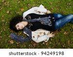 beautiful young girl lies down... | Shutterstock . vector #94249198