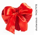 red woolen heart with silk ribbon isolated on white - stock photo