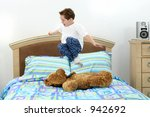 five year old boy in pajamas... | Shutterstock . vector #942692