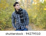 Young stylish man portrait in autumn park. Outdoor. - stock photo