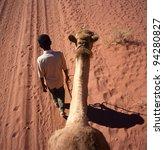 A camel trip through Wadi Rum desert, Jordan - stock photo