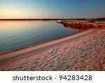 Beach and dock along shore of Lake Winnipeg