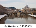 Rome with snow. On background the St. Peter's Basilica and Sant'Angelo bridge. - stock photo