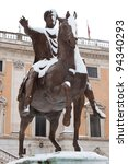 Marcus Aurelius on Capitol Hill in Rome with snow. - stock photo