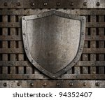 Aged Metal Shield On Wooden...