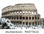 ROME - FEBRUARY 04: Amazing view of the Coliseum with snow on February 4, 2012. Snowfalls in Rome are very rare, the last similar snowfall was in 1985. - stock photo