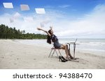 Happy asian businesswoman with working papers on the beach - stock photo