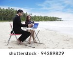 Casual business team meeting on the beach - stock photo