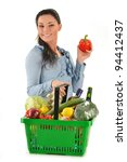 Young woman with shopping basket isolated on white - stock photo