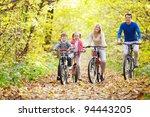 family on bikes in the park | Shutterstock . vector #94443205