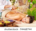 Young Woman Getting Massage In...