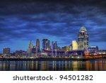 CINCINNATI – JANUARY 16: The skyline of Cincinnati, Ohio at night, January 16, 2012. Cincinnati is the third largest city in Ohio with a population of 296,943. - stock photo