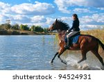 Stock photo pretty girl riding horse in shallow river water 94524931