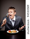 Man burning his mouth on hot food - stock photo