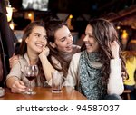 three beautiful girls in a bar | Shutterstock . vector #94587037