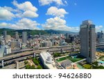 Hanshine Expressway winds through the cityscape of Kobe, Japan. - stock photo