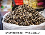 Black Melon Seeds on sale in Bangkok's Chinatown, Thailand. - stock photo