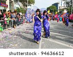 LIMASSOL, CYPRUS - MARCH 6, 2011: Unidentified participants  in Chinese costumes during the carnival parade, established in16th century, influenced by Venetians. - stock photo