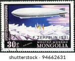MONGOLIA - CIRCA 1977: A stamp printed in Mongolia shows dirigible balloon F.Zeppelin over North Pole, Dirigibles, series, circa 1977 - stock photo