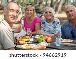 family eating picnic in the... | Shutterstock . vector #94662919