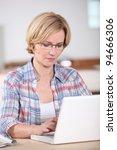 woman using a laptop computer... | Shutterstock . vector #94666306