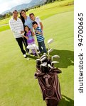 Family at the golf field looking happy - stock photo