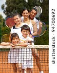 Five member family at the tennis court - stock photo