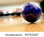 Purple bawling ball in an alley - stock photo