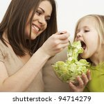 mother feeds little girl with... | Shutterstock . vector #94714279