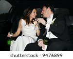 bride and groom in limo - stock photo