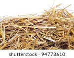 A Pile Of Straw On A White...