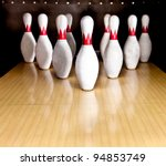 Ten white pins in a bowling alley - stock photo