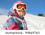 Little girl on the snow - stock photo