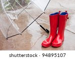 Umbrella And Rain Boots On A...